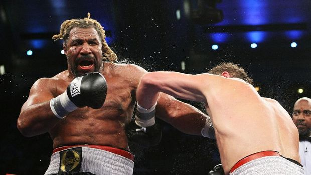 ATLANTIC CITY, NJ - JUNE 2:  Shannon Briggs punches Sultan Ibragimov during their WBO Heavyweight Championship fight at Boardwalk Hall June 2, 2007 in Atlantic City, New Jersey.  Ibragimov won by a unanimous decision.  (Photo by Al Bello/Getty Images) *** Local Caption *** Shannon Briggs;Sultan Ibragimov
