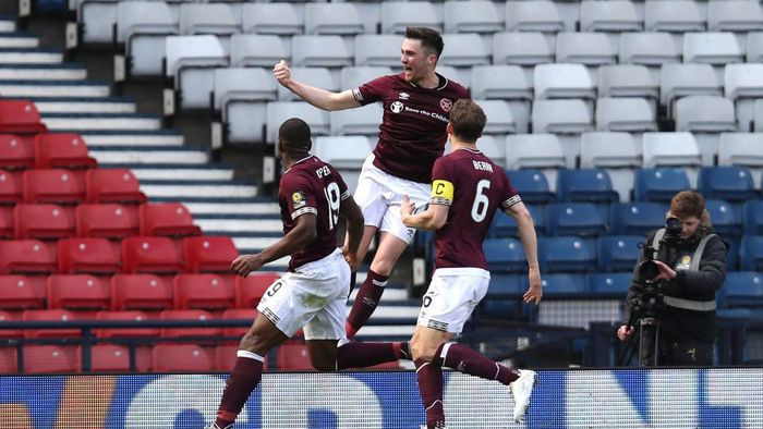 GLASGOW, SCOTLAND - APRIL 13: John Souttar of Heart of Midlothian F.C. celebrates after scoring his teams second goal with Uche Ikpeazu of of Heart of Midlothian F.C. and Christophe Berra of Heart of Midlothian F.C.  during the Scottish Cup Semi Final match between Heart of Midlothian and Inverness Caledonian Thistle at Hampden Park on April 13, 2019 in Glasgow, Scotland. (Photo by Ian MacNicol/Getty Images)