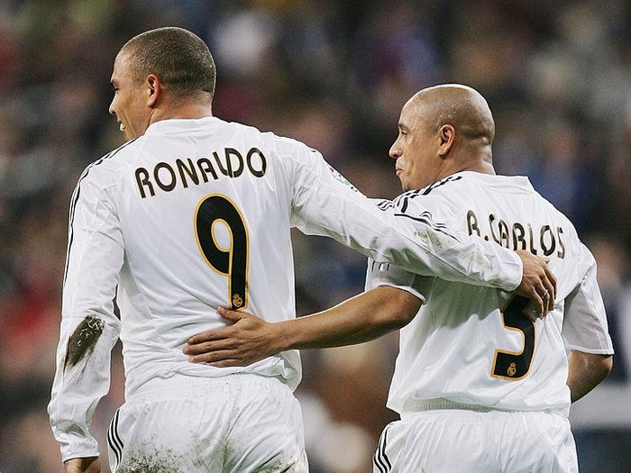 MADRID, SPAIN - DECEMBER 12: Ronaldo of Real Madrid celebrates with Roberto Carlos after scoring a goal against Real Sociedad during a Real Madrid v Real Sociedad Primera Liga match at the Bernabeu on December 12, 2004, in Madrid, Spain. (Photo by Denis Doyle/Getty Images)