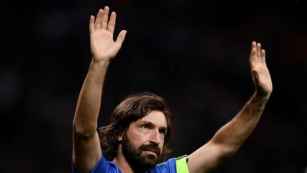 Former Italian football player Andrea Pirlo waves at the end of the