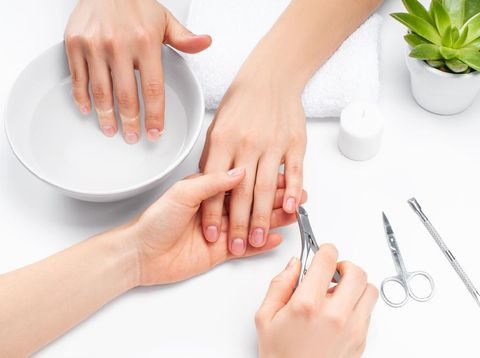 Hands care in the spa. Beautiful woman's hands with perfect manicure. Manicurist master makes manicure