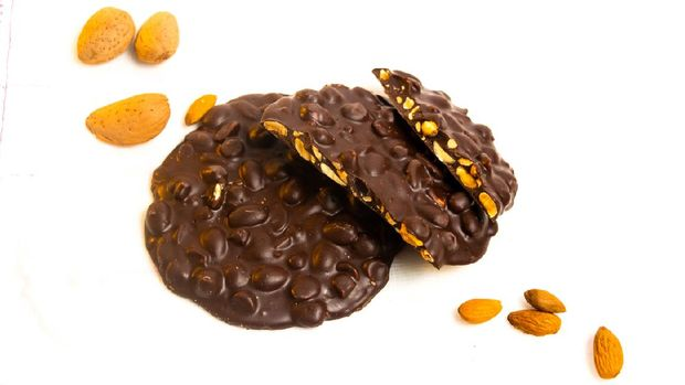Chocolate biscuits with almond isolated on white