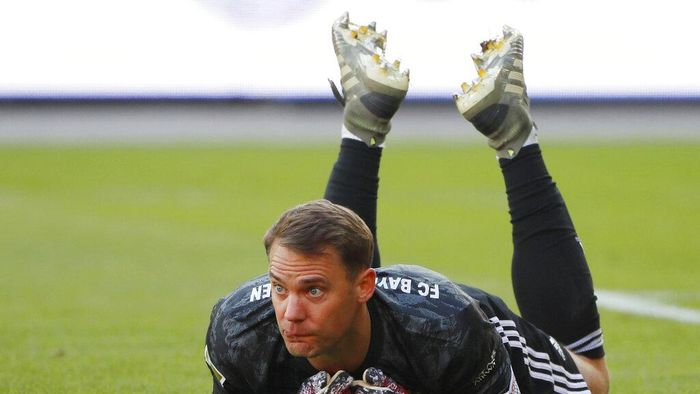 Goal keeper Manuel Neuer of Munich lies on the pitch during the German Bundesliga soccer match between Union Berlin and Bayern Munich in Berlin, Germany, Sunday, May 17, 2020. The German Bundesliga becomes the worlds first major soccer league to resume after a two-month suspension because of the coronavirus pandemic. (AP Photo/Hannibal Hanschke, Pool)