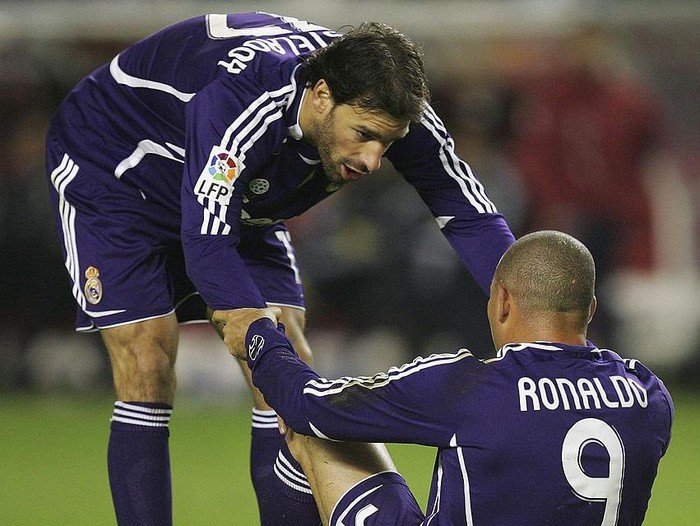 SEVILLE, SPAIN - DECEMBER 09: Ruud van Nistelrooy of Real Madrid checks-up on Ronaldo after he was injured during the Primera Liga match between Sevilla and Real Madrid at the Sanchez Pizjuan stadium on December 9, 2006 in Seville, Spain.  (Photo by Denis Doyle/Getty Images)