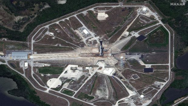 This photo provided by Maxar's WorldView-3 satellite shows an overview of Launch Pad 39A and the SpaceX Falcon 9 rocket with the Crew Dragon spacecraft on top of the rocket, Saturday, May 23, 2020, at Kennedy Space Center, in Florida. NASA is preparing for its first manned flight in nearly a decade from the United States. (Satellite image ©2020 Maxar Technologies via AP)
