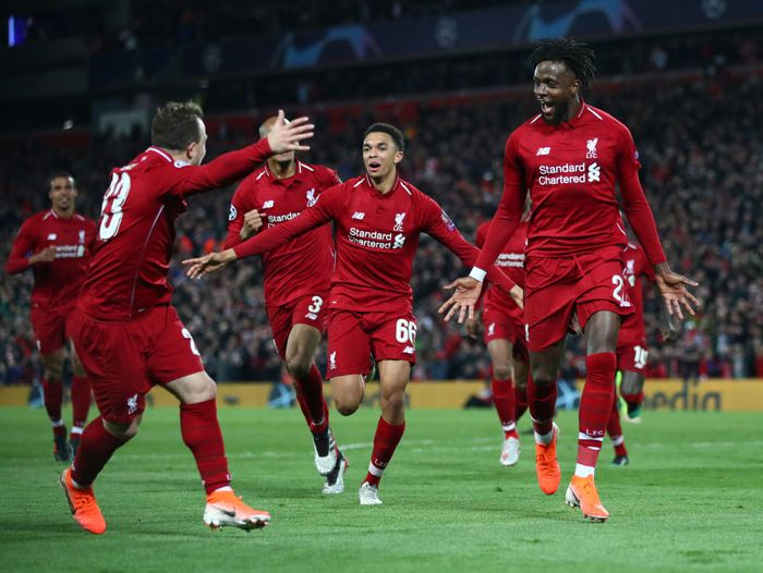 LIVERPOOL, ENGLAND - MAY 07:  Divock Origi of Liverpool (27) celebrates as he scores his teams fourth goal with team mates during the UEFA Champions League Semi Final second leg match between Liverpool and Barcelona at Anfield on May 07, 2019 in Liverpool, England. (Photo by Clive Brunskill/Getty Images)