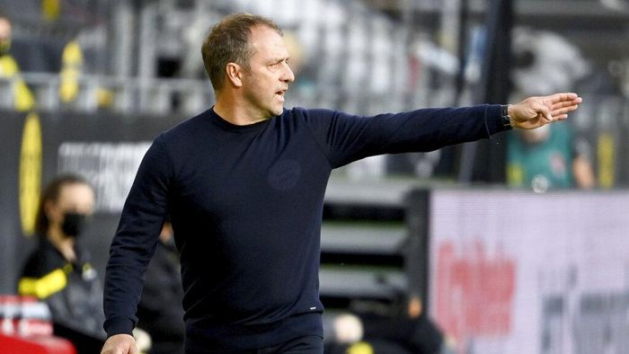 Munichs head coach Hansi Flick gestures during the German Bundesliga soccer match between Borussia Dortmund and FC Bayern Munich in Dortmund, Germany, Tuesday, May 26, 2020. The German Bundesliga is the worlds first major soccer league to resume after a two-month suspension because of the coronavirus pandemic. (Federico Gambarini/DPA via AP, Pool)