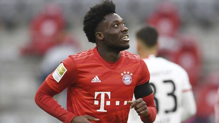 Bayern Munichs Alphonso Davies celebrates scoring Munichs fourth goal during the German Bundesliga soccer match between Bayern Munich and Eintracht Frankfurt in Munich, Germany, Saturday, May 23, 2020. (Andreas Gebert/pool via AP)