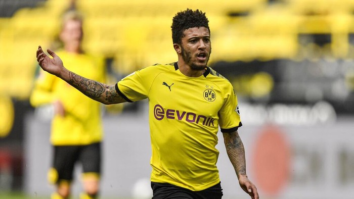 Dortmunds Jadon Sancho plays during the German Bundesliga soccer match between Borussia Dortmund and Schalke 04 in Dortmund, Germany, Saturday, May 16, 2020. The German Bundesliga becomes the worlds first major soccer league to resume after a two-month suspension because of the coronavirus pandemic. (AP Photo/Martin Meissner, Pool)