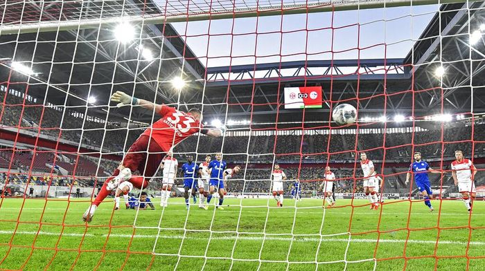 Schalkes Weston McKennie, left on the ground, scores the opening goal against Duesseldorfs goalkeeper Florian Kastenmeier during the German Bundesliga soccer match between Fortuna Duesseldorf and FC Schalke 04 in Duesseldorf, Germany, Wednesday, May 27, 2020. The German Bundesliga becomes the worlds first major soccer league to resume after a two-month suspension because of the coronavirus pandemic. (AP Photo/Martin Meissner, Pool)