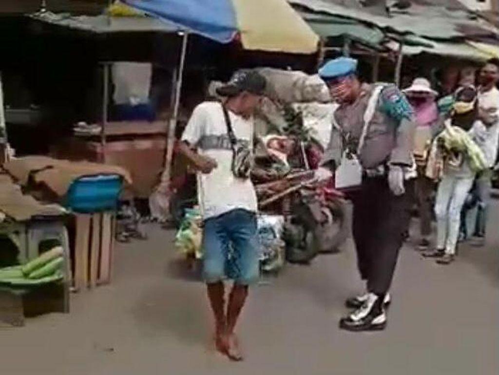 Polisi yang Viral Pecut Warga Tak Bermasker Ditahan Propam Polda Maluku