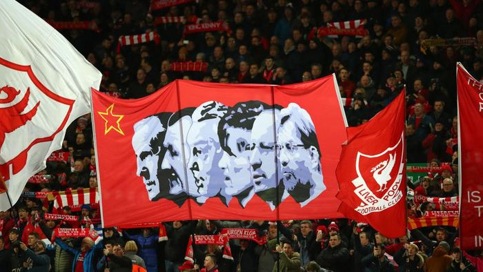 LIVERPOOL, ENGLAND - FEBRUARY 24: Liverpool fans hold up flags inside the stadium prior to kick off during the Premier League match between Liverpool FC and West Ham United at Anfield on February 24, 2020 in Liverpool, United Kingdom. (Photo by Clive Brunskill/Getty Images)