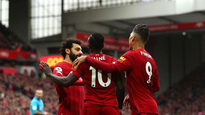 LIVERPOOL, ENGLAND - MARCH 07: Sadio Mane of Liverpool celebrates with Mohamed Salah and Roberto Firmino after scoring his teams second goal during the Premier League match between Liverpool FC and AFC Bournemouth  at Anfield on March 07, 2020 in Liverpool, United Kingdom. (Photo by Jan Kruger/Getty Images)