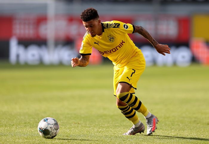 PADERBORN, GERMANY - MAY 31: Jadon Sancho of Dortmund runs with the ball during the Bundesliga match between SC Paderborn 07 and Borussia Dortmund at Benteler Arena on May 31, 2020 in Paderborn, Germany. (Photo by Lars Baron/Getty Images)