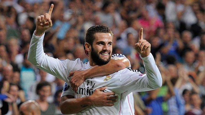 MADRID, SPAIN - SEPTEMBER 16:  Nacho Fernandez of Real Madrid celebrates after scoring Reals opening goal during the UEFA Champions League Group B match between Real Madrid CF and FC Basel 1893 on September 16, 2014 in Madrid, Spain.  (Photo by Denis Doyle/Getty Images)