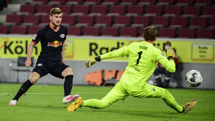 Leipzigs German forward Timo Werner, left, scores his side third goal past Colognes German goalkeeper Timo Horn during the German Bundesliga soccer match between 1. FC Cologne and RB Leipzig, in Cologne, Germany, Monday, June 1, 2020. Because of the coronavirus outbreak all soccer matches of the German Bundesliga take place without spectators. (Ina Fassbender/Pool via AP)