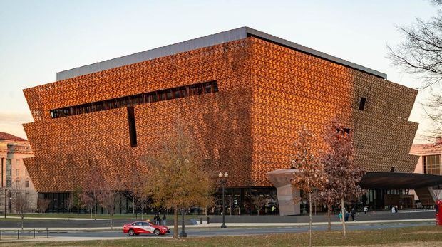Washington, DC - December 21, 2017: Detailed scrim of Museum of African American History and Culture. Bronze colored aluminum scrim features geometric patterns based on historic iron grilles.
