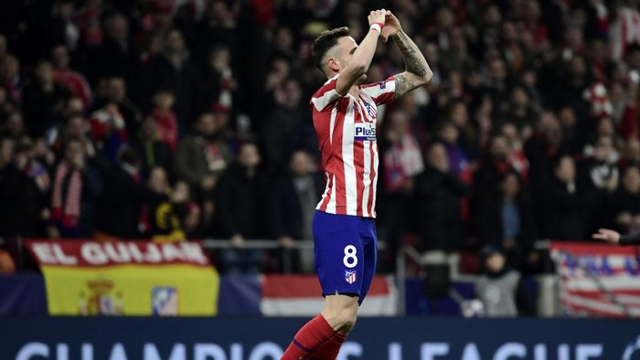 Atletico Madrids Spanish midfielder Saul Niguez celebrates after scoring the opening goal during the UEFA Champions League, round of 16, first leg football match between Club Atletico de Madrid and Liverpool FC at the Wanda Metropolitano stadium in Madrid on February 18, 2020. (Photo by JAVIER SORIANO / AFP)