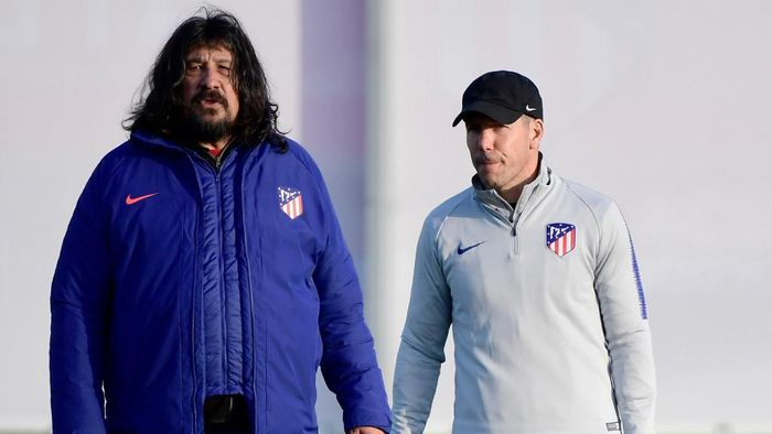 (FILES) In this file photo taken on February 19, 2019 Atletico Madrids Argentinian coach Diego Simeone (R) and Argentinian assistant coach German