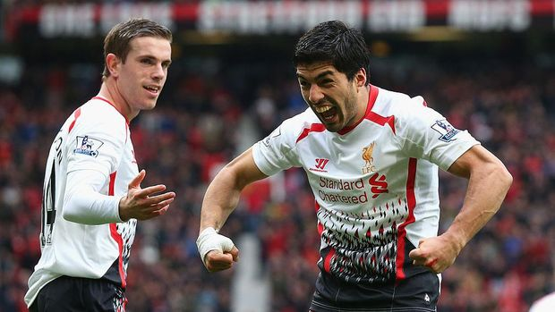 MANCHESTER, ENGLAND - MARCH 16:  Luis Suarez of Liverpool celebrates scoring his team's third goal with team-mate Jordan Henderson (L) during the Barclays Premier League match between Manchester United and Liverpool at Old Trafford on March 16, 2014 in Manchester, England.  (Photo by Alex Livesey/Getty Images)
