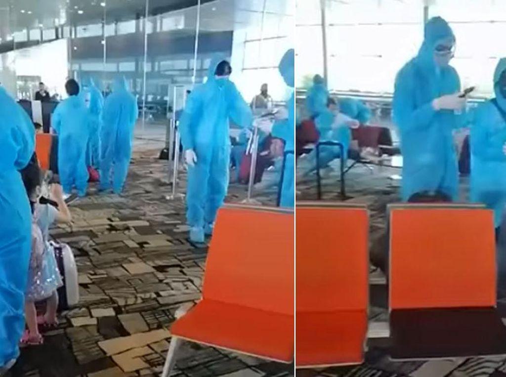 Bikin Heboh di Changi, Penumpang Pesawat Pakai APD Warna Biru