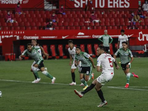 Sevilla and Betis players during their Spanish La Liga soccer match in Seville, Spain, Thursday, June 11, 2020. With virtual crowds, daily matches and lots of testing for the coronavirus, soccer is coming back to Spain. The Spanish league resumes this week more than three months after it was suspended because of the pandemic, becoming the second top league to restart in Europe. The Bundesliga was first. The Premier League and the Italian league should be next in the coming weeks. (AP Photo)