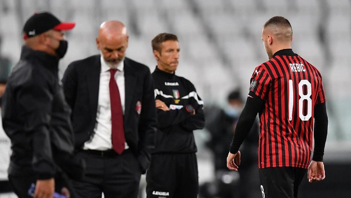 TURIN, ITALY - JUNE 12:  Ante Rebic of AC Milan walks off the pitch after being sent off during the Coppa Italia Semi-Final Second Leg match between Juventus and AC Milan at Allianz Stadium on June 12, 2020 in Turin, Italy.  (Photo by Valerio Pennicino/Getty Images)