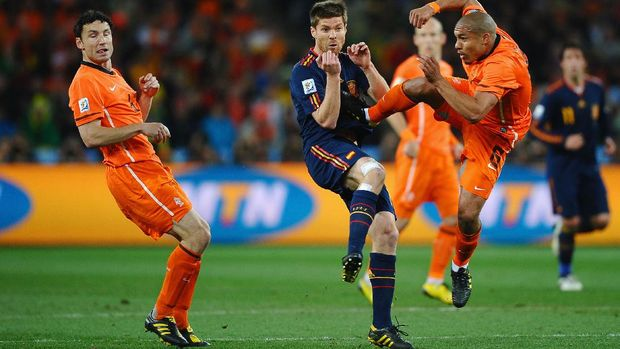 JOHANNESBURG, SOUTH AFRICA - JULY 11:  Nigel De Jong of the Netherlands tackles Xabi Alonso of Spain with a kick in the chest during the 2010 FIFA World Cup South Africa Final match between Netherlands and Spain at Soccer City Stadium on July 11, 2010 in Johannesburg, South Africa.  (Photo by Laurence Griffiths/Getty Images)