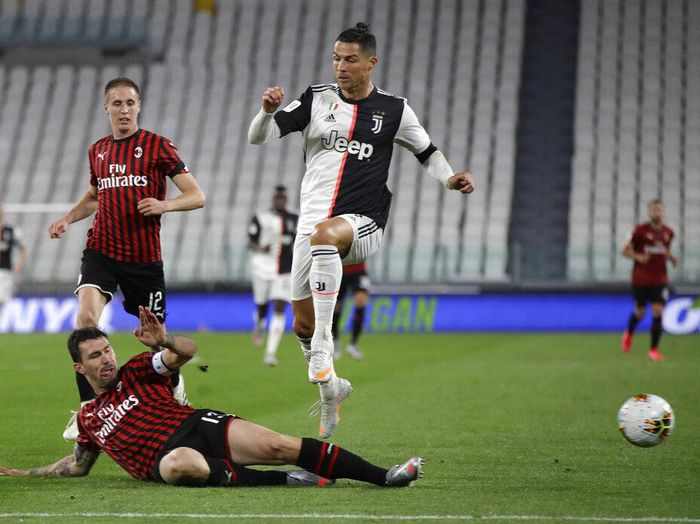 AC Milans Alessio Romagnoli tackles Juventus Cristiano Ronaldo during an Italian Cup second leg soccer match between Juventus and AC Milan at the Allianz stadium, in Turin, Italy, Friday, June 12, 2020. (AP Photo/Luca Bruno)