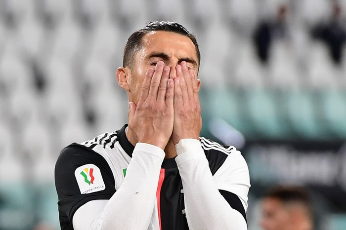 Juventus Portuguese forward Cristiano Ronaldo reacts after missing a penalty during the Italian Cup (Coppa Italia) semi-final second leg football match Juventus vs AC Milan on June 12, 2020 at the Allianz stadium in Turin, the first to be played in Italy since March 9 and the lockdown aimed at curbing the spread of the COVID-19 infection, caused by the novel coronavirus. (Photo by Miguel MEDINA / AFP)