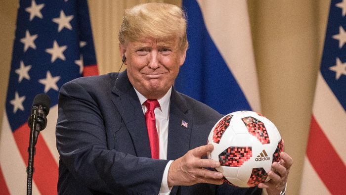 HELSINKI, FINLAND - JULY 16: President Donald Trump shows off a World Cup football given to him by Russian President Vladimir Putin during a joint press conference after their summit on July 16, 2018 in Helsinki, Finland. The two leaders met one-on-one and discussed a range of issues including the 2016 U.S Election collusion.  (Photo by Chris McGrath/Getty Images)