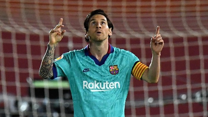 MALLORCA, SPAIN - JUNE 13: Lionel Messi of FC Barcelona celebrates  after scoring his sides fourth goal during the La Liga match between RCD Mallorca and FC Barcelona at Estadio de Son Moix on June 13, 2020 in Mallorca, Spain. (Photo by David Ramos/Getty Images)