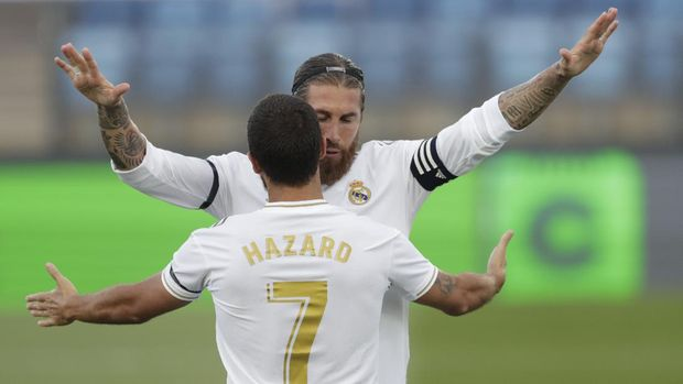 Real Madrid's Sergio Ramos celebrates his goal with Real Madrid's Eden Hazard during the Spanish La Liga soccer match between Real Madrid and Eibar at Alfredo di Stefano stadium in Madrid, Spain, Sunday, June 14, 2020. (AP Photo/Bernat Armangue)