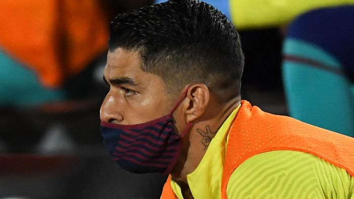 MALLORCA, SPAIN - JUNE 13: Luis Suarez of FC Barcelona wearing a protection face mask looks on during the Liga match between RCD Mallorca and FC Barcelona at Estadio de Son Moix on June 13, 2020 in Mallorca, Spain. (Photo by David Ramos/Getty Images)