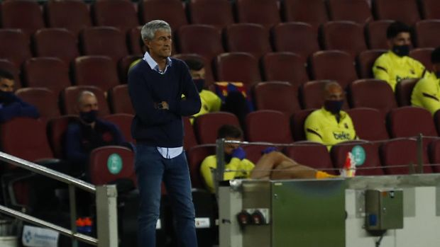 Barcelona's head coach Quique Setien follows the match during the Spanish La Liga soccer match between FC Barcelona and Leganes at the Camp Nou stadium in Barcelona, Spain, Tuesday, June 16, 2020. (AP Photo/Joan Montfort)