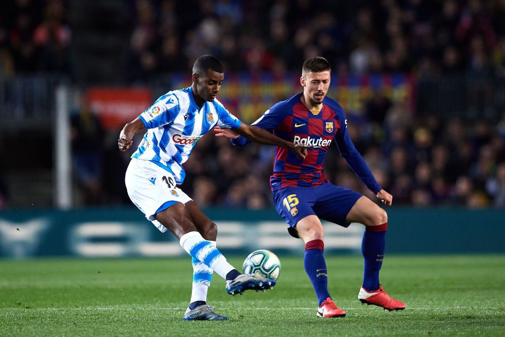 BARCELONA, SPAIN - MARCH 07: Alexander Isak of Real Sociedad battles for possession with Clement Lenglet of FC Barcelona during the La Liga match between FC Barcelona and Real Sociedad at Camp Nou on March 07, 2020 in Barcelona, Spain. (Photo by Alex Caparros/Getty Images)