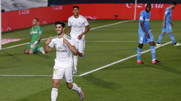 Real Madrid's Marco Asensio celebrates after scoring his side's second goal during the Spanish La Liga soccer match between Real Madrid and Valencia at Alfredo di Stefano stadium in Madrid, Spain, Thursday, June 18, 2020. (AP Photo/Manu Fernandez)