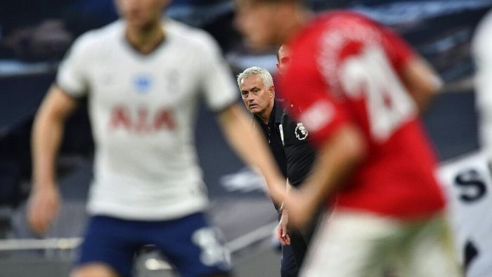 Tottenhams manager Jose Mourinho watches play during the English Premier League soccer match between Tottenham Hotspur and Manchester United at Tottenham Hotspur Stadium in London, England, Friday, June 19, 2020. (AP Photo/Glyn Kirk, Pool)