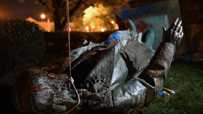 The statue of Confederate general Albert Pike is pictured after it was toppled by protesters at Judiciary square in Wahsington, DC on late June 19, 2020. - Protesters have toppled the only statue of a Confederate general in the US capital, images broadcast by US media show. President Donald Trump tweeted that the Washington