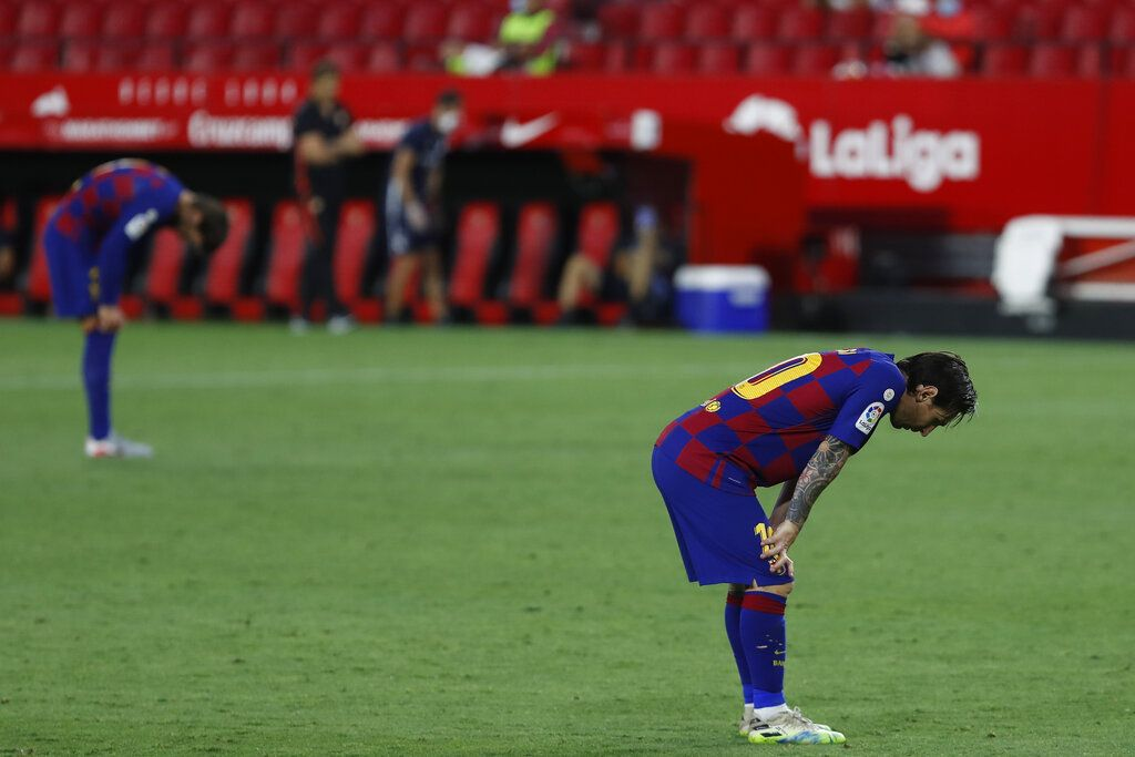 Barcelona's Lionel Messi reacts during the Spanish La Liga soccer match between Sevilla and FC Barcelona at the Ramon Sanchez-Pizjuan stadium in Seville, Spain, Friday, June 19, 2020. (AP Photo/Angel Fernandez)