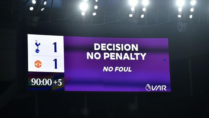 LONDON, ENGLAND - JUNE 19: The LED screen displays a No Penalty decision after it is ruled out by VAR during the Premier League match between Tottenham Hotspur and Manchester United at Tottenham Hotspur Stadium on June 19, 2020 in London, England. (Photo by Glyn Kirk/ Pool via Getty Images)