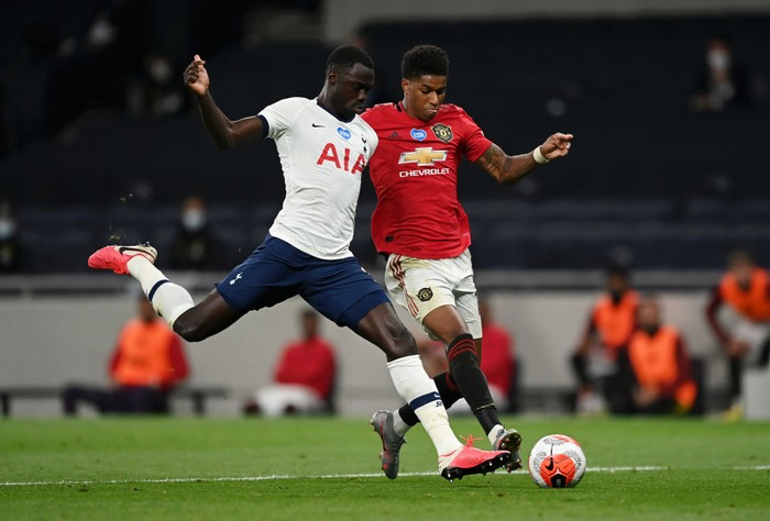 LONDON, ENGLAND - JUNE 19: Marcus Rashford of Manchester United is tackled by Davinson Sanchez of Tottenham Hotspur  during the Premier League match between Tottenham Hotspur and Manchester United at Tottenham Hotspur Stadium on June 19, 2020 in London, England. (Photo by Shaun Botterill/Getty Images)