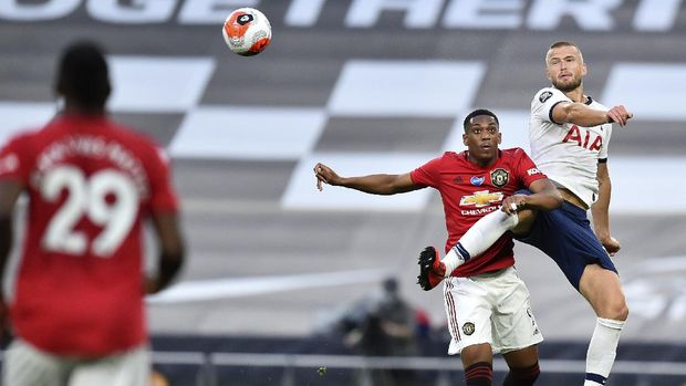 Manchester United's Anthony Martial and Tottenham's Eric Dier, right, battle for the ball during the English Premier League soccer match between Tottenham Hotspur and Manchester United at Tottenham Hotspur Stadium in London, England, Friday, June 19, 2020. (AP Photo/Glyn Kirk, Pool)