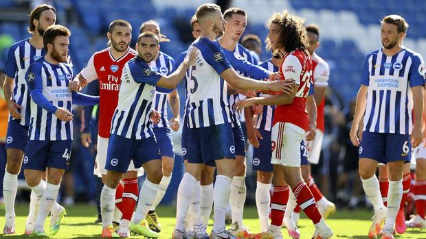 Brighton's Adam Webster, center, gets between Brighton's Neal Maupay, center left, and Arsenal's Matteo Guendouzi during an argument at the end of the English Premier League soccer match between Brighton & Hove Albion and Arsenal at the AMEX Stadium in Brighton, England, Saturday, June 20, 2020. (Richard Heathcote/Pool via AP)
