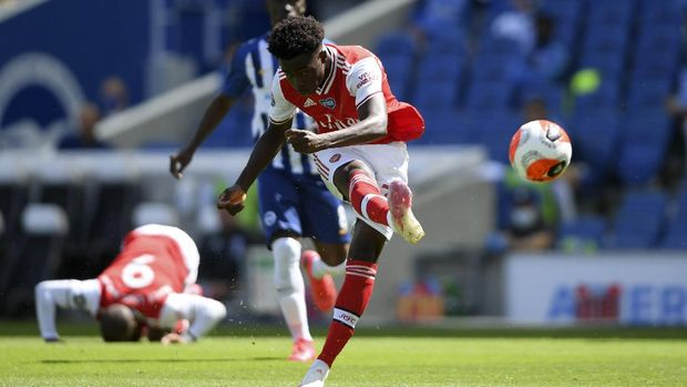 Arsenal's Bukayo Saka attempts a shot at goal during the English Premier League soccer match between Brighton & Hove Albion and Arsenal at the AMEX Stadium in Brighton, England, Saturday, June 20, 2020. (Mike Hewitt/Pool via AP)