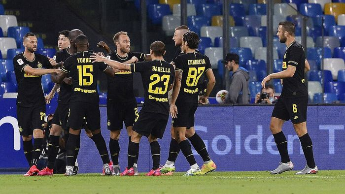 Inter Milans Christian Eriksen, 5th from right, celebrates with teammates after scoring his sides opening goal during the Italian Cup second leg semifinal soccer match between Napoli and Inter Milan, at the Naples San Paolo Stadium, Italy, Saturday, June 13, 2020. The match is being played without spectators because of the COVID-19 restriction measures. (Cafaro/LaPresse via AP)