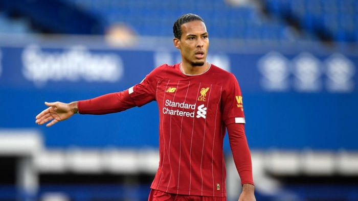 LIVERPOOL, ENGLAND - JUNE 21: Virgil van Dijk of Liverpool looks on during the Premier League match between Everton FC and Liverpool FC at Goodison Park on June 21, 2020 in Liverpool, England. Football Stadiums around Europe remain empty due to the Coronavirus Pandemic as Government social distancing laws prohibit fans inside venues resulting in all fixtures being played behind closed doors. (Photo by Peter Powell/Pool via Getty Images)