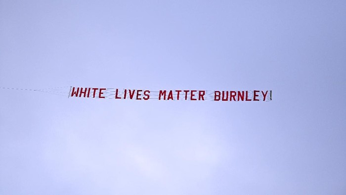 MANCHESTER, ENGLAND - JUNE 22: A plane flies over the stadium with a banner reading White Lives Matter Burnley  during the Premier League match between Manchester City and Burnley FC at Etihad Stadium on June 22, 2020 in Manchester, England. Football stadiums around Europe remain empty due to the Coronavirus Pandemic as Government social distancing laws prohibit fans inside venus resulting in all fixtures being played behind closed doors. (Photo by Shaun Botterill/Getty Images)