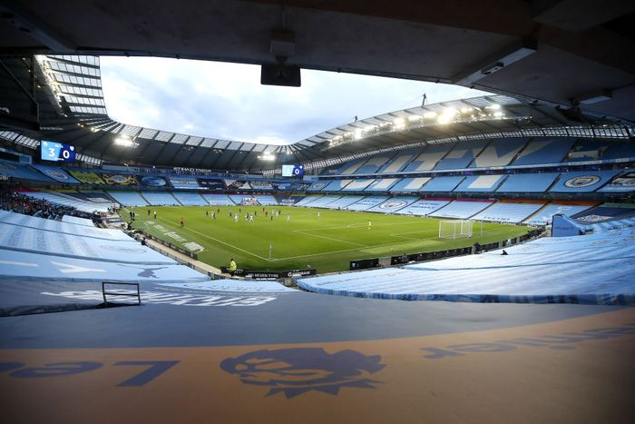 MANCHESTER, ENGLAND - JUNE 22: General view inside the stadium showing the empty seat coverings during the Premier League match between Manchester City and Burnley FC at Etihad Stadium on June 22, 2020 in Manchester, England. Football stadiums around Europe remain empty due to the Coronavirus Pandemic as Government social distancing laws prohibit fans inside venues resulting in all fixtures being played behind closed doors. (Photo by Martin Rickett/Pool via Getty Images)