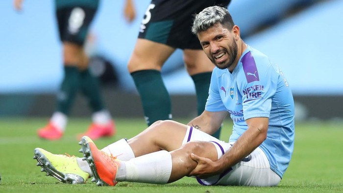 MANCHESTER, ENGLAND - JUNE 22: Sergio Aguero of Manchester City reacts while sitting on the pitch injured during the Premier League match between Manchester City and Burnley FC at Etihad Stadium on June 22, 2020 in Manchester, England. Football stadiums around Europe remain empty due to the Coronavirus Pandemic as Government social distancing laws prohibit fans inside venues resulting in all fixtures being played behind closed doors. (Photo by Martin Rickett/Pool via Getty Images)